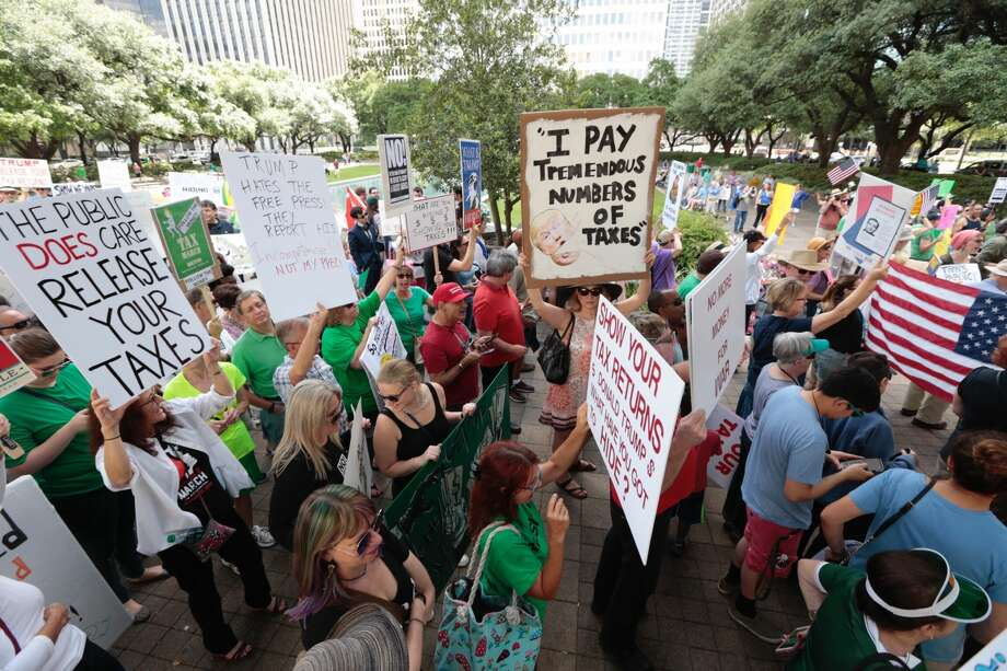 Demonstrators begin a march demanding greater governmental transparency and the release of President Donald Trump's tax returns during a protest on Saturday, April 15, 2017, in Houston. (Brett Coomer / Houston Chronicle) Photo: Brett Coomer/Brett Coomer / Houston Chronicle