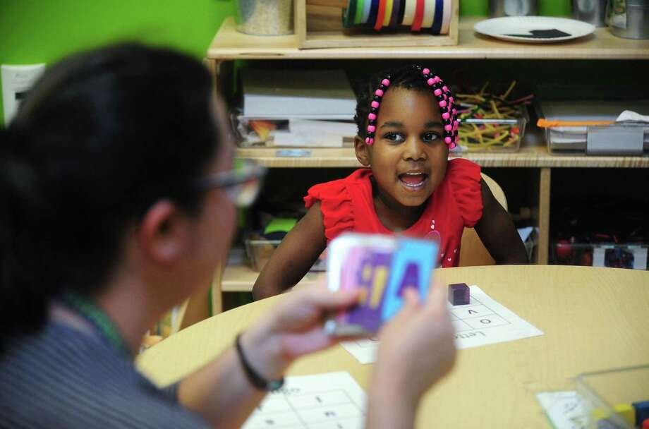 Tri'shelle Jones, 4, sounds out letters during a game of Letter Bingo as part of Elli Adventures in the Early Language and Literacy Initiative (ELLI ) Center at the Stepping Stones Museum for Children Tuesday, April 11, 2017, in Norwalk, Conn. For the past five years ELLI has been a joint collaboration between Stepping Stones Museum for Children and Literacy How, an organization dedicated to the application of early literacy research. The five ELLI model classroom sites in Southwestern Connecticut are located at Stepping Stones, ELLI at Fairfield University and three at Norwalk public schools; Fox Run Elementary School, Tracey Elementary School and Naramake Elementary School. Photo: Erik Trautmann / Hearst Connecticut Media / Norwalk Hour