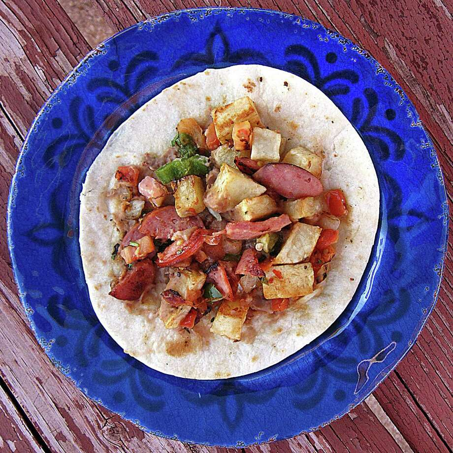 The Lalo taco with beans, country sausage, fried potatoes and pico de gallo on a handmade flour tortilla from El Toro Mexican Food. Photo: Mike Sutter /San Antonio Express-News