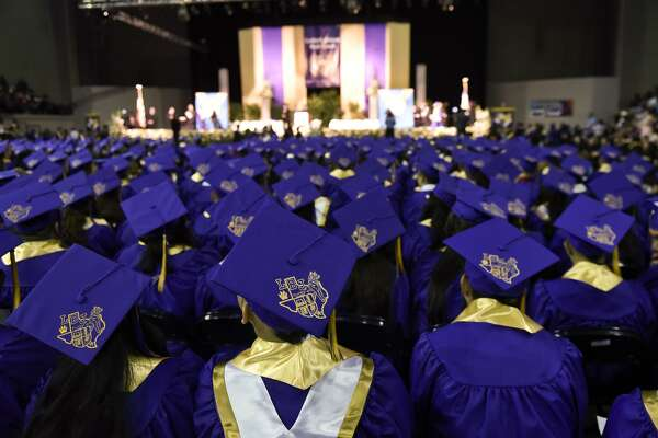 In this June 2015 file photo, Lyndon B. Johnson High School students await their turn to walk the stage during the school's graduation ceremony at the Laredo Energy Arena.