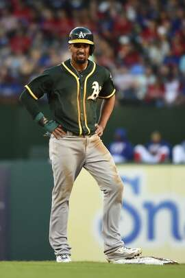 Oakland Athletics' Marcus Semien stands at second base after advancing on a fielder's choice against the Texas Rangers in the first inning of a baseball game, Saturday, April 8, 2017, in Arlington, Texas. (AP Photo/Jeffrey McWhorter)