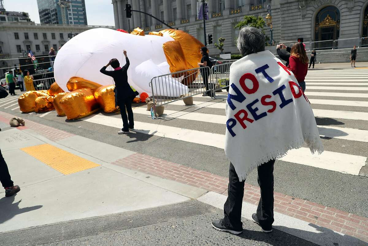 Rally organizers inflate a Trump Chicken before Tax Day rally in San Francisco, Calif., on Saturday, April 15, 2017.