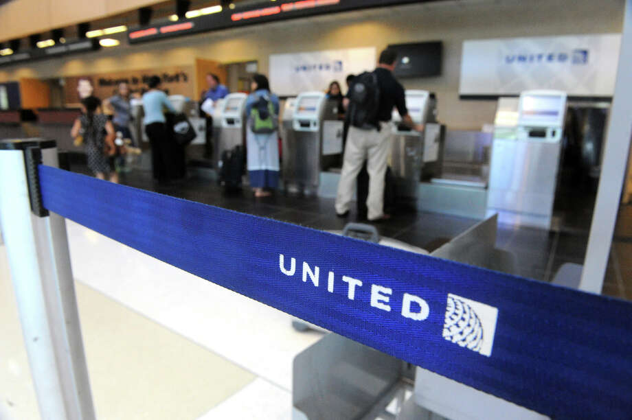 The United Airlines ticket counter at Albany International Airport on Wednesday May 27, 2015 in  Colonie, N.Y.  (Michael P. Farrell/Times Union) Photo: Michael P. Farrell / 00032047A