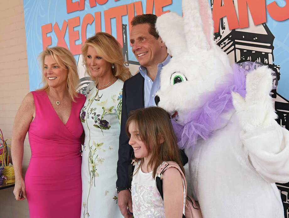 Laura Morton of Saratoga, left, and her daughter Sevey, 8, get their photo taken with Sandra Lee, Gov. Andrew Cuomo and the Easter Bunny as Cuomo greets New Yorkers at an Easter Sunday open house and egg hunt at the Executive Mansion on Saturday, April 15, 2017 in Albany, N.Y. (Lori Van Buren / Times Union) Photo: Lori Van Buren / 20040208A
