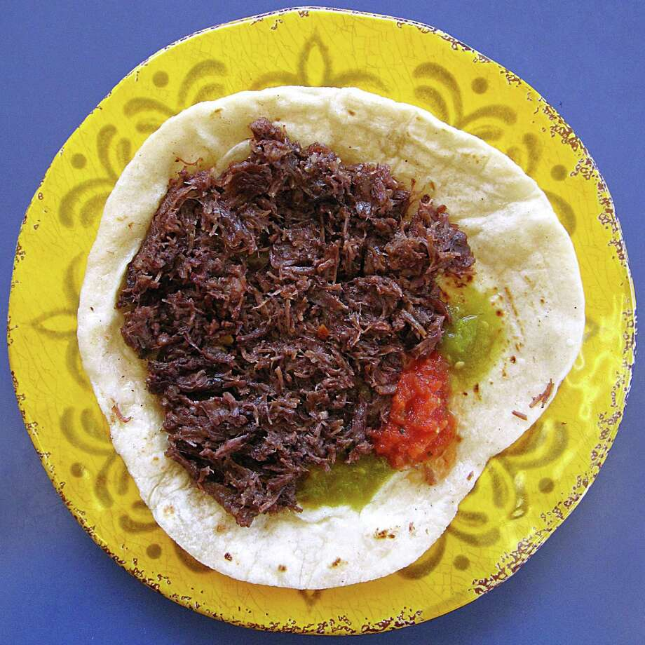 Barbacoa taco on a handmade flour tortilla from Culebra Cafe on Pat Booker Road. Photo: Mike Sutter /San Antonio Express-News