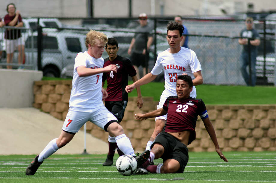 Waller senior midfielder Ricardo Lopez (22) slides for a possession against Frisco Wakeland freshman forward Todd Fuller (7) during the first period of their Class 5A Boys final matchup at the 2017 UIL Soccer State Championships at Birkelbach Field in Georgetown on Saturday, April 15, 2017. (Photo by Jerry Baker/Freelance) Photo: Jerry Baker, For The Chronicle / Freelance