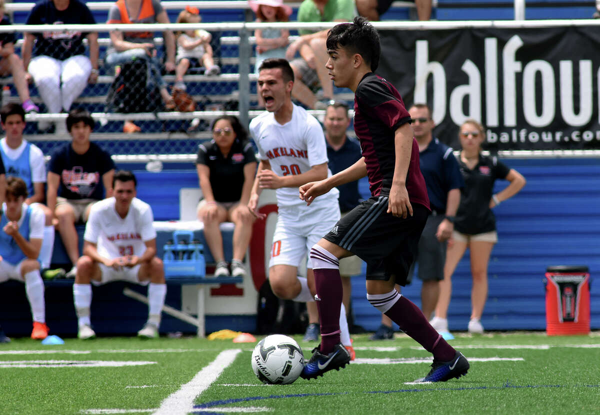 Waller junior midfielder David Jara works the ball upfield against the Frisco Wakeland defense during the first period of their Class 5A Boys final matchup at the 2017 UIL Soccer State Championships at Birkelbach Field in Georgetown on Saturday, April 15, 2017. (Photo by Jerry Baker/Freelance)