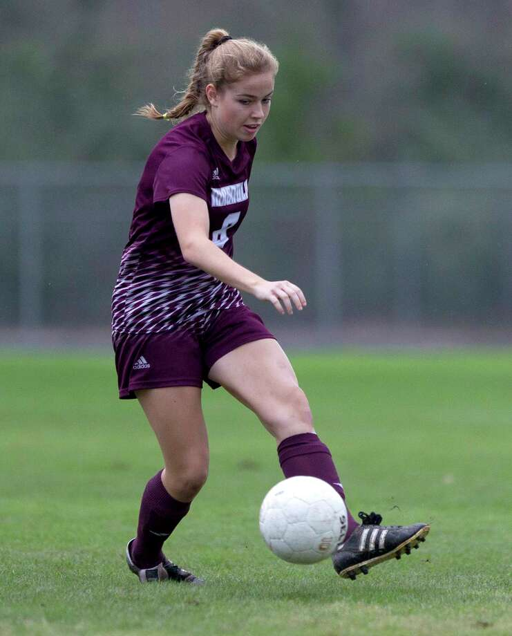 Magnolia midfielder Brooke Mallory (8) makes a pass down field during the first period of a high school girls soccer match in the Texans Drive Tournament at Porter High School Friday, Jan. 20, 2017, in Porter. Photo: Jason Fochtman, Staff Photographer / © 2017 Houston Chronicle