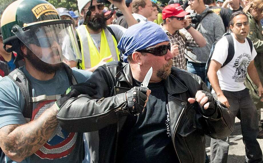 A demonstrator supporting President Donald Trump wields a knife during a fight with counter-protesters on Saturday, April 15, 2017, in Berkeley, Calf. Photo: Noah Berger, Special To The Chronicle
