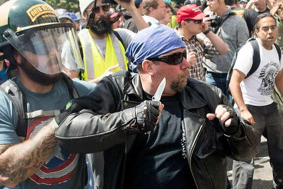 A demonstrator supporting President Donald Trump wields a knife during a fight with counter-protesters on Saturday, April 15, 2017, in Berkeley, Calf.