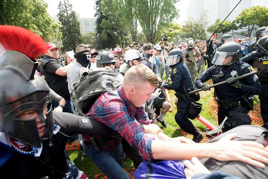 Protesters for and against President Donald Trump brawl on Saturday, April 15, 2017, in Berkeley, Calf. Photo: Noah Berger, Special To The Chronicle