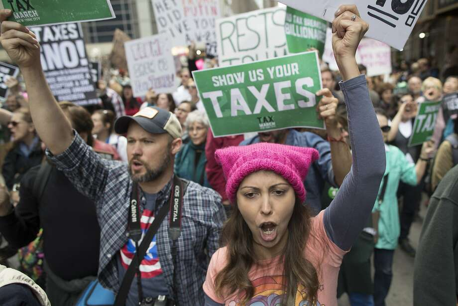 Demonstrators participate in a march and rally to demand President Donald Trump release his tax returns, Saturday, April 15, 2017, in New York. Protesters took to the streets in dozens of cities nationwide Saturday to call on President Donald Trump to release his tax returns, saying Americans deserve to know about his business ties and potential conflicts of interest. (AP Photo/Mary Altaffer) Photo: Mary Altaffer, Associated Press