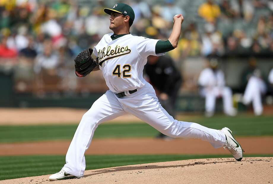 OAKLAND, CA - APRIL 15:  Sean Manaea #55 of the Oakland Athletics pitches against the Houston Astros in the top of the first inning at Oakland Alameda Coliseum on April 15, 2017 in Oakland, California. All players are wearing #42 in honor of Jackie Robinson Day.  (Photo by Thearon W. Henderson/Getty Images) Photo: Thearon W. Henderson, Getty Images