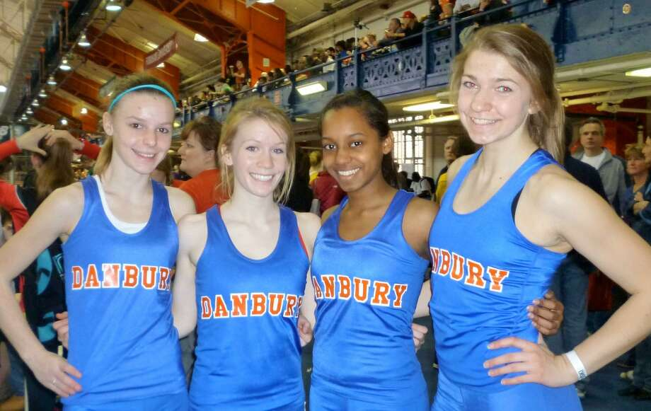 The Danbury 4x800 relay team of, from left, Maddie Daly, Sarah Eyman, Layla Rashid and Allie Bukowski at the Indoor National Championships at the New York City Armory in 2011. Photo: Contributed Photo / Contributed Photo