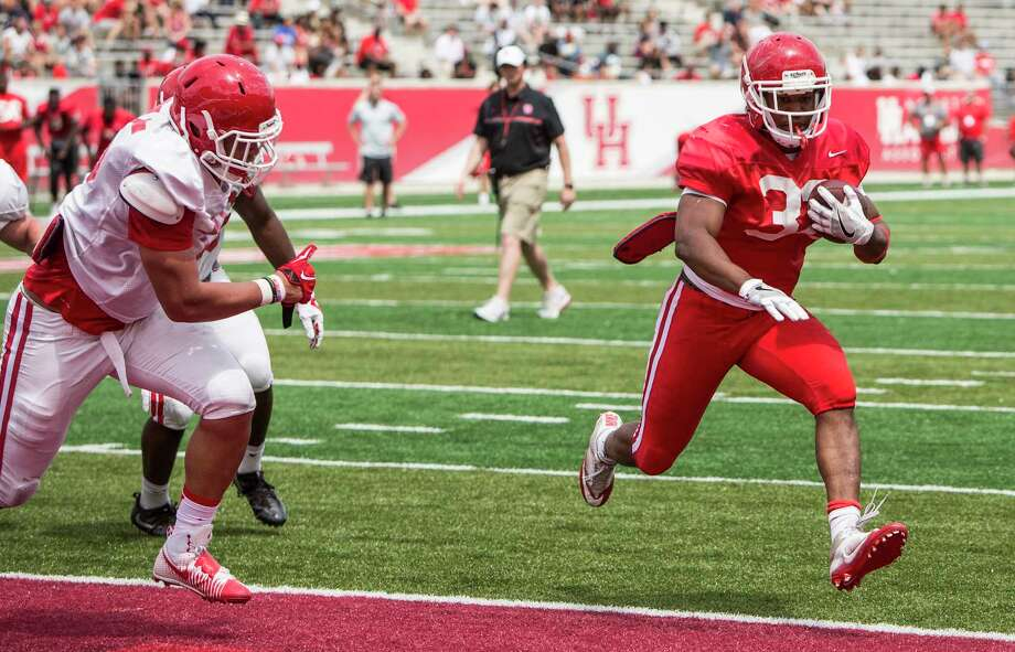 Houston running back Kevrin Justice (32) scores on a 1-yard touchdown run during the University of Houston Red-White Game at TDECU Stadium on Saturday, April 15, 2017, in Houston. Photo: Brett Coomer, Houston Chronicle / © 2017 Houston Chronicle