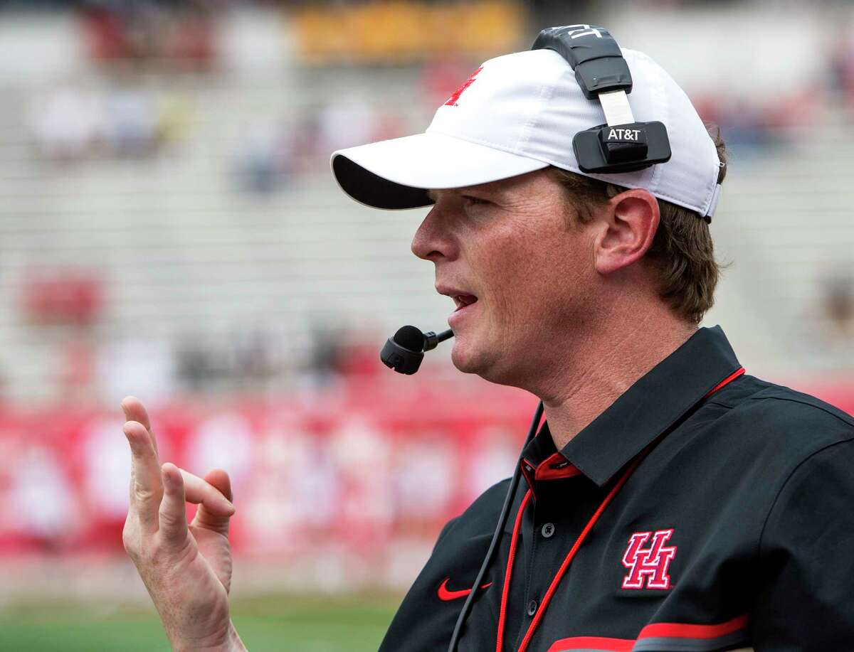 Houston head coach Major Applewhite makes a call from the sidelines during the University of Houston Red-White Game at TDECU Stadium on Saturday, April 15, 2017, in Houston.