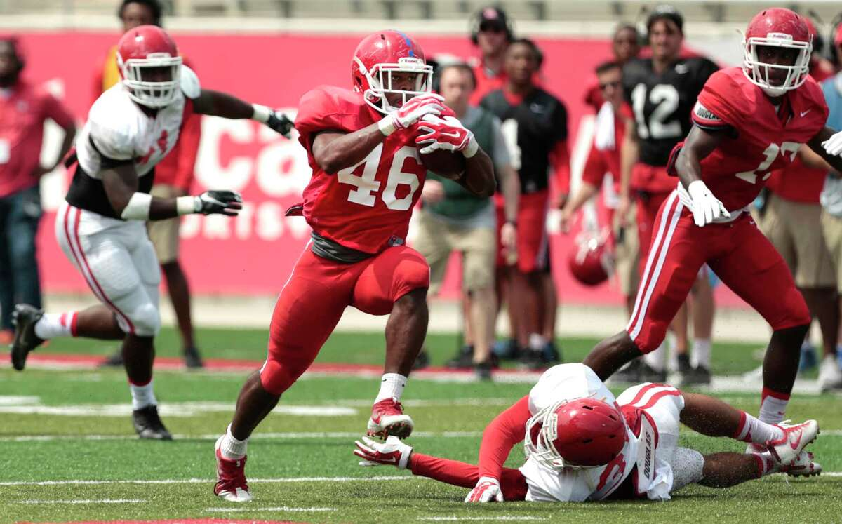 Houston running back Patrick Carr (46) breaks away for a 52-yard run during the University of Houston Red-White Game at TDECU Stadium on Saturday, April 15, 2017, in Houston.