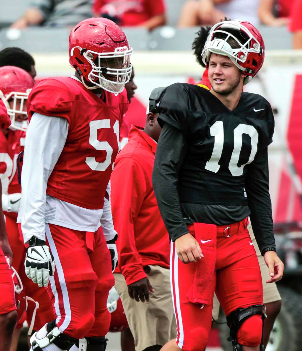 Houston offensive lineman Na'Ty Rodgers (51) walks up the sidelines with quarterback Kyle Allen (10) on the sidelines during the University of Houston Red-White Game at TDECU Stadium on Saturday, April 15, 2017, in Houston.