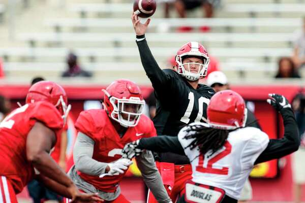 Houston quarterback Kyle Allen (10) throws a pass over linebacker d'Juan Hines (12) during the University of Houston Red-White Game at TDECU Stadium on Saturday, April 15, 2017, in Houston.
