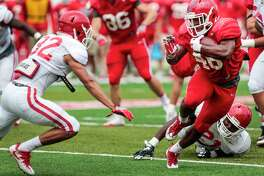 Houston running back Patrick Carr (46) cuts back across the field past linebacker Khari Dotson (32) during the University of Houston Red-White Game at TDECU Stadium on Saturday, April 15, 2017, in Houston.
