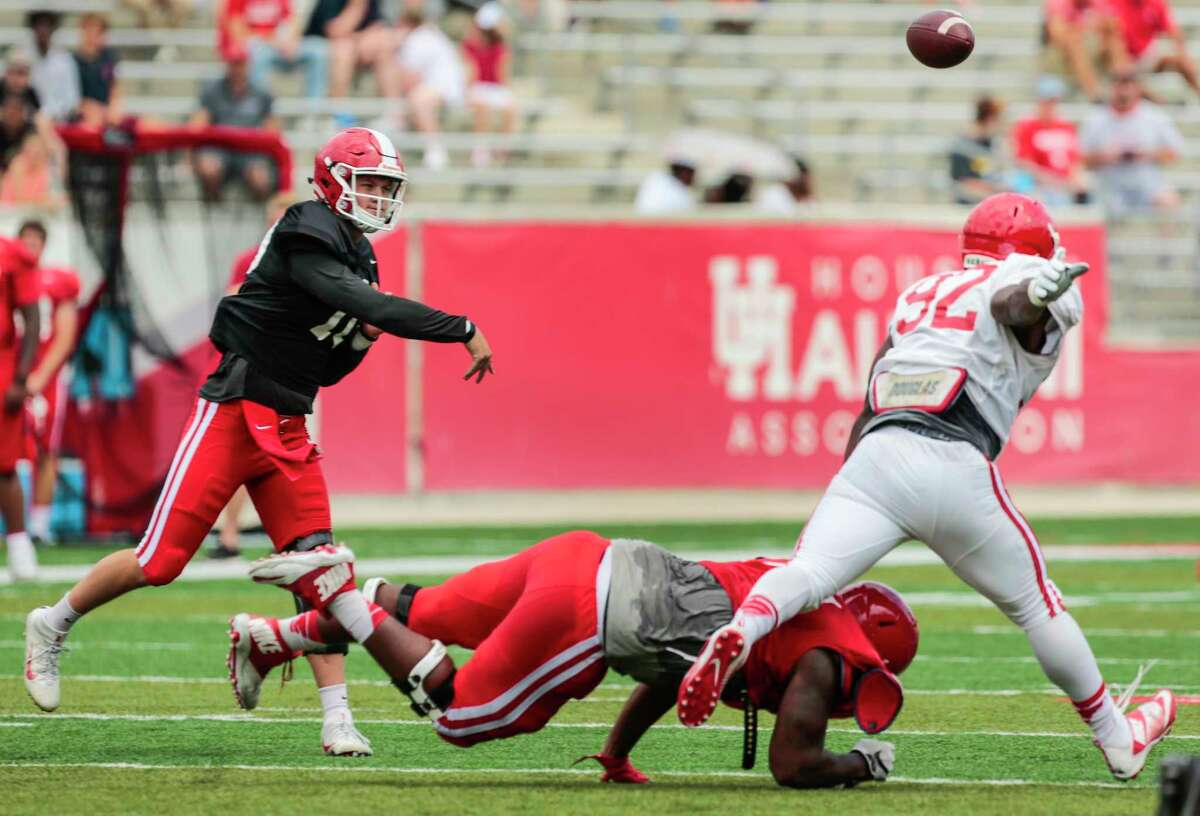 Houston quarterback throws a pass over defensive end Tito Ejiogu (92) during the University of Houston Red-White Game at TDECU Stadium on Saturday, April 15, 2017, in Houston.