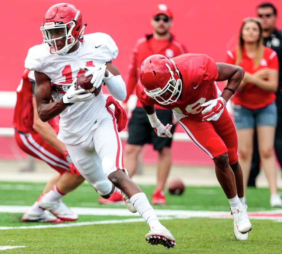 Houston cornerback Isaiah Johnson (14) intercepts a pass intended for wide receiver Keith Corbin (18) during the University of Houston Red-White Game at TDECU Stadium on Saturday, April 15, 2017, in Houston. Photo: Brett Coomer, Houston Chronicle / © 2017 Houston Chronicle