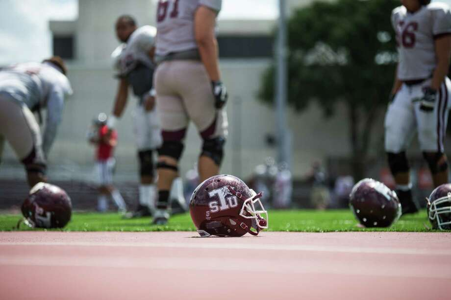 TSU football helmets lay on the field mat during the TSU Spring Football at Durley Stadium, Saturday, April 15, 2017, in Houston. (Juan DeLeon/for the Houston Chronicle ) Photo: Juan DeLeon, For The Chronicle / Houston Chronicle