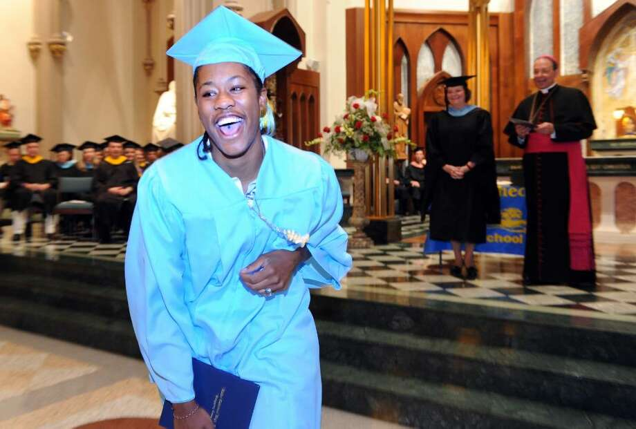 Tiarrah Thompson, of Stratford, walks back to her seat with diploma in hand during the 2010 Kolbe Cathedral High School graduation ceremony Thursday June 3 at St. Augustine Cathedral in Bridgeport. Photo: Autumn Driscoll / Connecticut Post