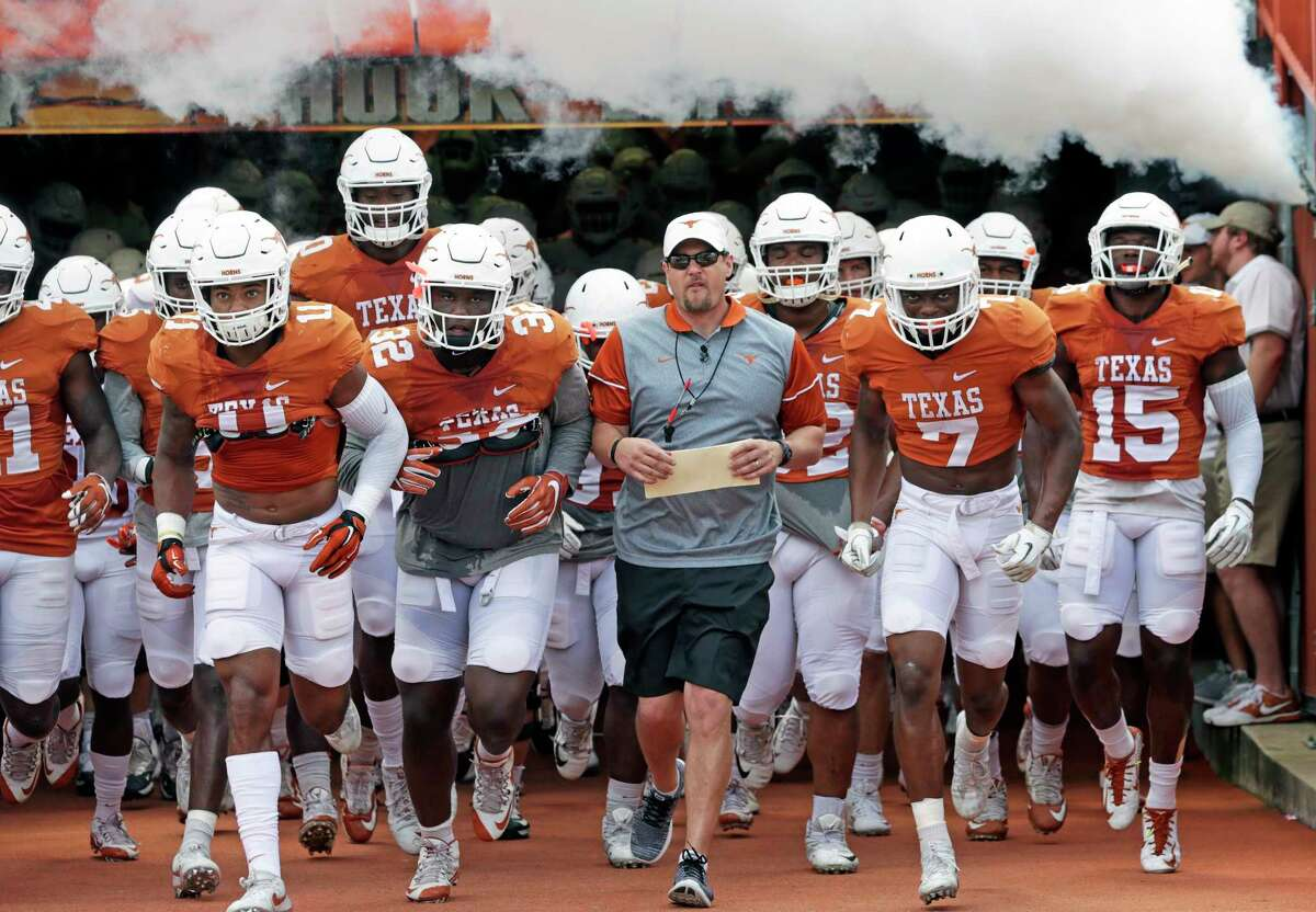 Head coach Tom Herman leads his players onto the field as the Texas Longhorns play their Orange-White spring game on April 15, 2017.