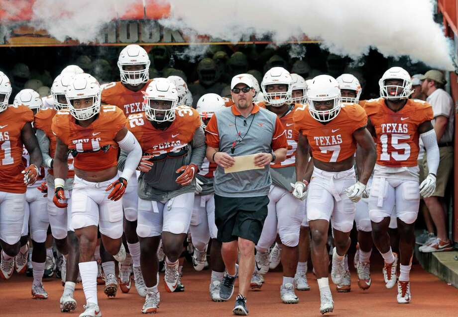 Head coach Tom Herman leads his players onto the field as the Texas Longhorns play their Orange-White spring game on April 15, 2017. Photo: Tom Reel, San Antonio Express-News / 2017 SAN ANTONIO EXPRESS-NEWS