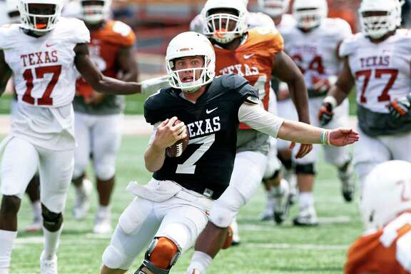 Quarterback Shane Buechele gets loose in the secondary as the Texas Longhorns play their Orange-White spring game on April 15, 2017.