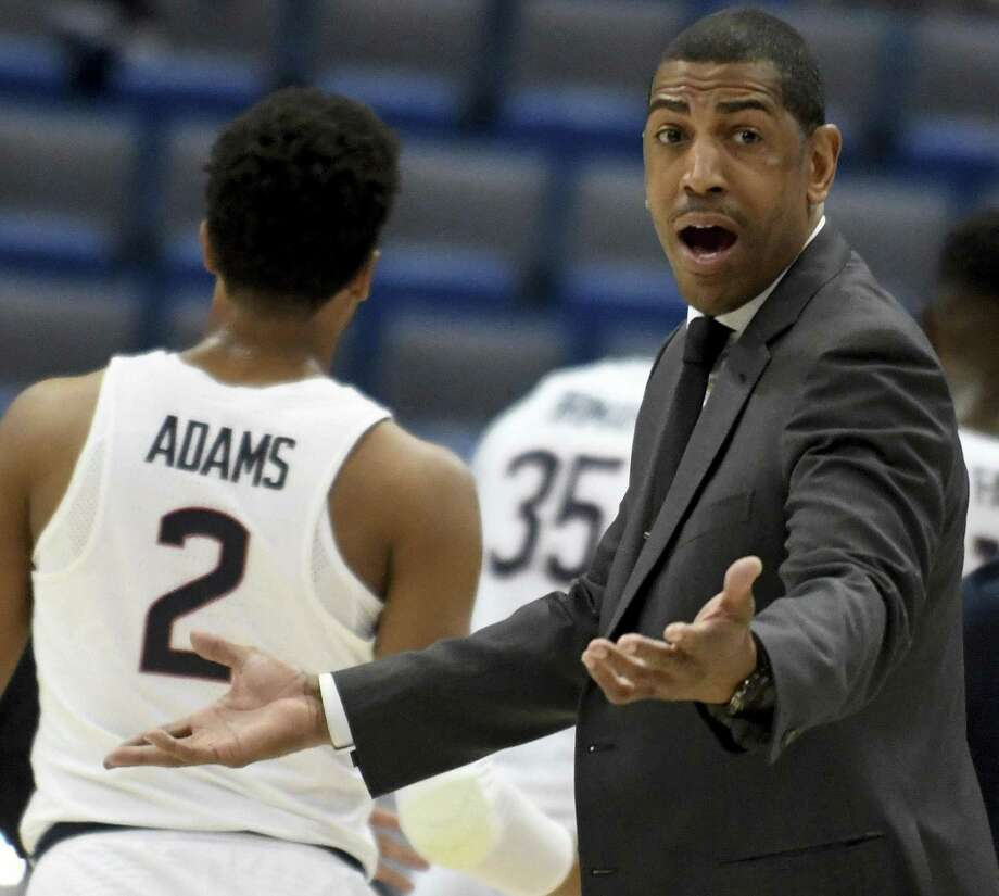 UConn coach Kevin Ollie questions a call during the first half against South Florida in the first round of the AAC tournament in March in Hartford. Photo: Jim Michaud / Associated Press / AP2017