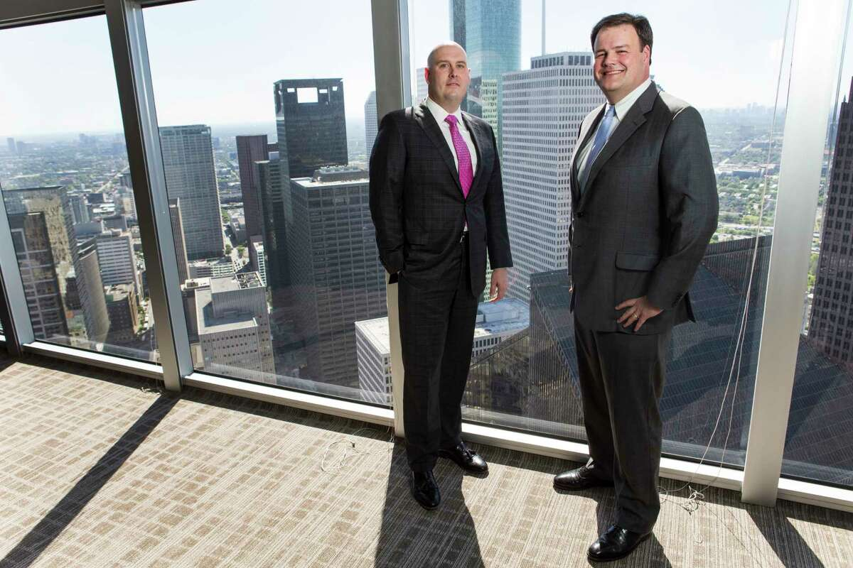 Ian Faria and Jim Collura pose for a photo at their new law firm, Bradley Law Firm, on Tuesday, March 21, 2017, in Houston. They left Coats Rose in October to join Bradley, a Birmingham, Ala., based firm to open an office in Houston. ( Brett Coomer / Houston Chronicle )