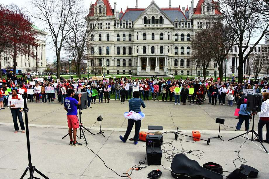Greg Jusino, 16, of Slingerlands (center in tutu) address a rally crowd of hundreds at the state Capitol on Saturday, April 15, 2017, in Albany. The protest was part of a national Tax March taking place in approximately 150 cities. (Steve Barnes/Times Union)