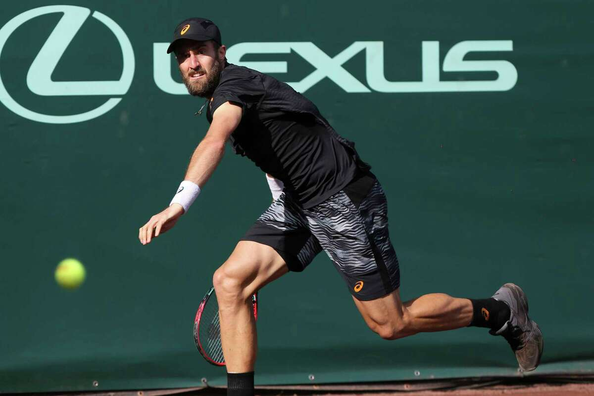 Steve Johnson, of the United States, prepares to hit a forehand to Jack Sock, of the United States, during the semifinals of the U.S. Men's Clay Court Championship tennis tournament at River Oaks Country Club on Saturday, April 15, 2017, in Houston. (Yi-Chin Lee / Houston Chronicle via AP)
