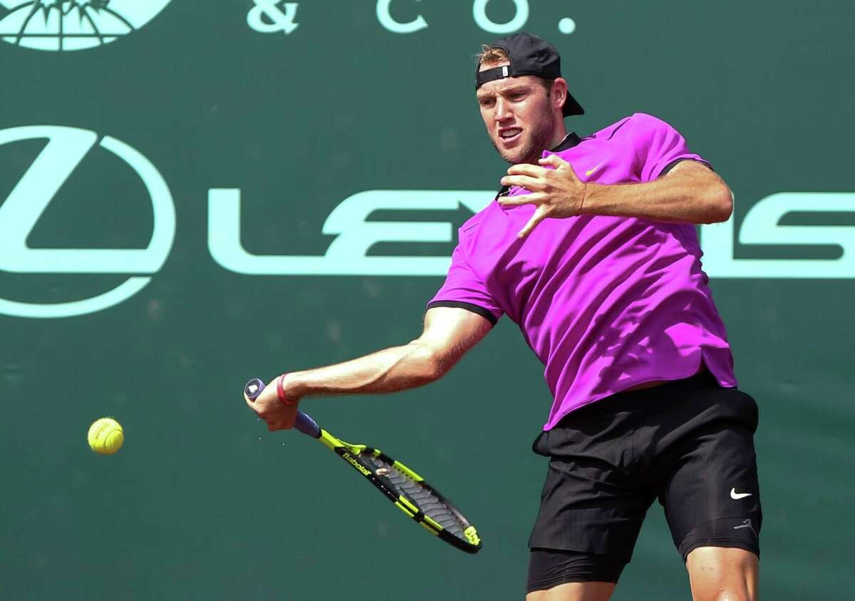 Jack Sock hits to Steve Johnson during the U.S. Men's Clay Court Championship at River Oaks Country Club, Saturday, April 15, 2017, in Houston. (Yi-Chin Lee/Houston Chronicle via AP)