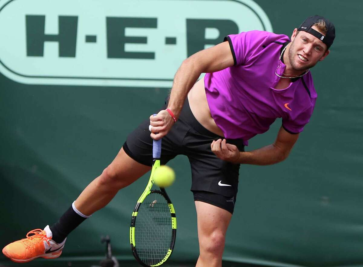 Jack Sock, of the United States, serves to countryman Steve Johnson during the semifinals of the U.S. Men's Clay Court Championship tennis tournament at River Oaks Country Club on Saturday, April 15, 2017, in Houston. (Yi-Chin Lee / Houston Chronicle via AP)