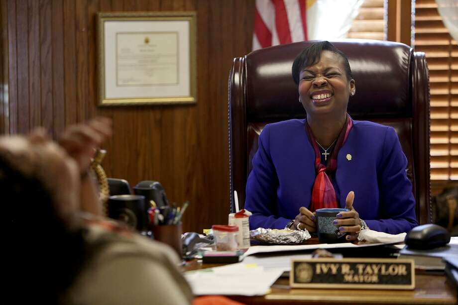Mayor Ivy Taylor laughs as she takes a break for a breakfast taco with Leslie Garza, Director of Communications for the Mayor's office, in her office at City Hall on February 22, 2017. Photo: Lisa Krantz / SAN ANTONIO EXPRESS-NEWS / SAN ANTONIO EXPRESS-NEWS