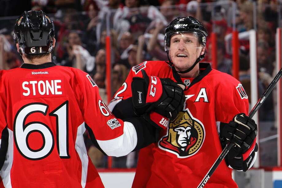 Dion Phaneuf (right) celebrates his overtime goal that won the game for Ottawa. Photo: Jana Chytilova/Freestyle Photo, Getty Images