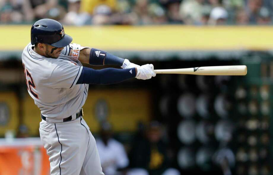Houston Astros Carlos Correa swings against the Oakland Athletics in the sixth inning of a baseball game Saturday, April 15, 2017, in Oakland, Calif. (AP Photo/Ben Margot) Photo: Ben Margot, Associated Press / AP
