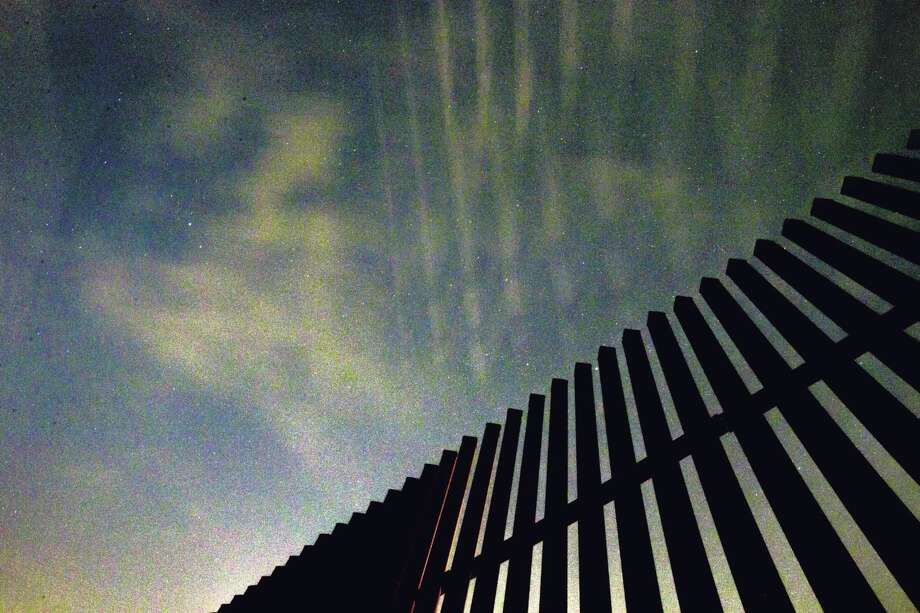 Stars appear on a clear night over the border fence Monday, Nov. 14, 2016 in Penitas. ( Michael Ciaglo / Houston Chronicle ) Photo: Michael Ciaglo, Staff / © 2016  Houston Chronicle