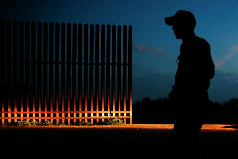 A Border Patrol agent guards a gap in the border fence in Penitas, west of McAllen. The Trump administration wants to expedite the hiring of 5,000 new agents. Photo: Michael Ciaglo, Staff / © 2016  Houston Chronicle