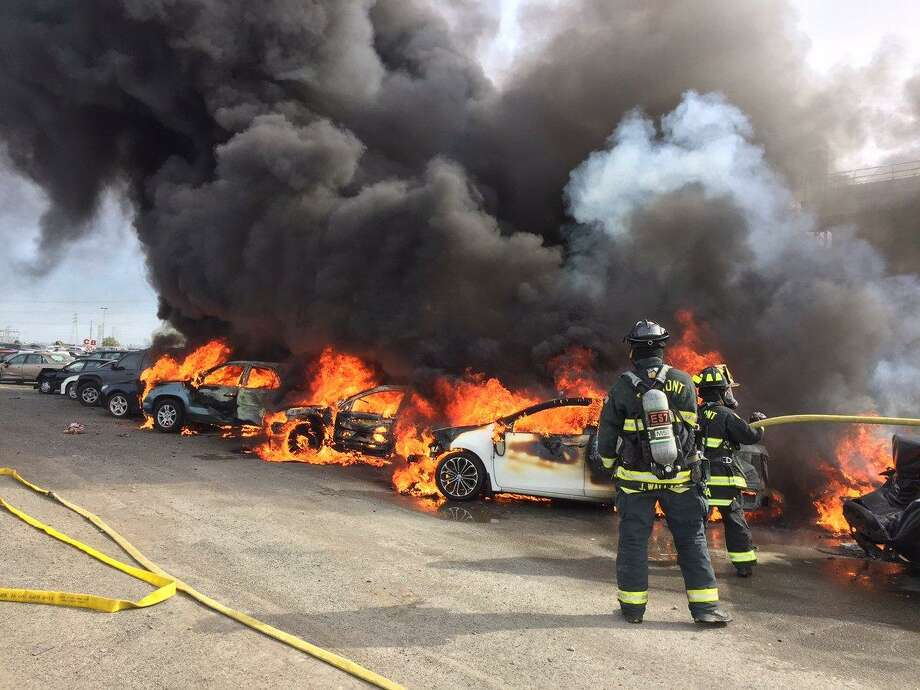 A fire swarmed through 35 cars at an auto auction dealership Saturday evening, officials said.