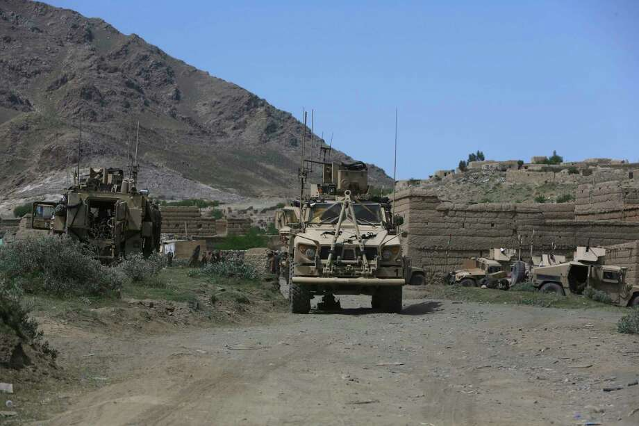 U.S. forces and Afghan commandos are seen in Asad Khil near the site of a U.S. bombing in the Achin district of Jalalabad, east of Kabul, Afghanistan, Saturday, April 17, 2017. U.S. forces in Afghanistan on Thursday struck an Islamic State tunnel complex in eastern Afghanistan with the largest non-nuclear weapon every used in combat by the U.S. military, Pentagon officials said. (AP Photo/Rahmat Gul) Photo: Rahmat Gul, STF / Copyright 2017 The Associated Press. All rights reserved.