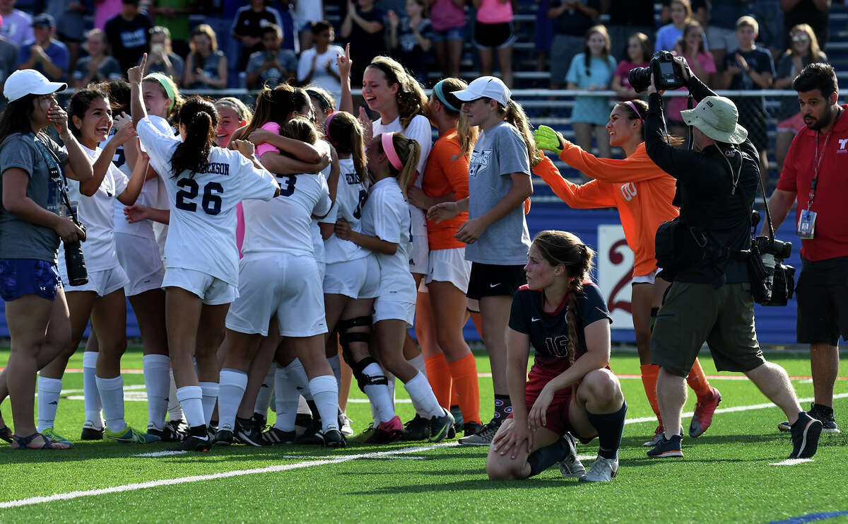 Katy Tompkins junior midfielder Seanna McCarty, right, watches as the Pflugerrville Hendrickson Hawks celebrate their 2-0 win over the Falcons in their Class 6A Girls Final matchup at the 2017 UIL Soccer State Championships at Birkelbach Field in Georgetown on Saturday, April 15, 2017. (Photo by Jerry Baker/Freelance)