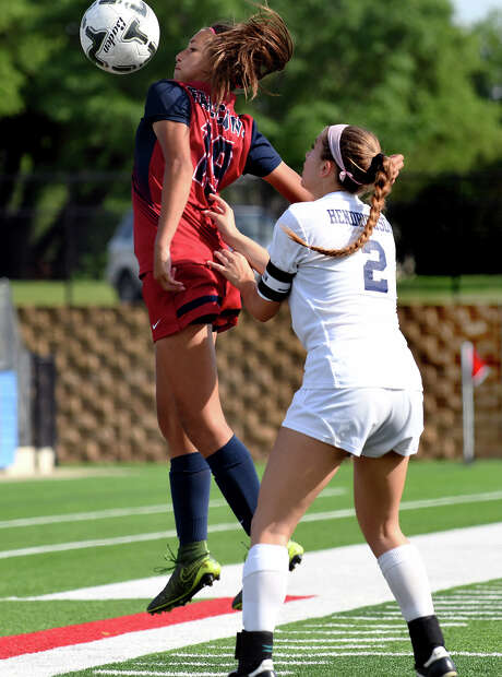 Katy Tompkins freshman forward Barbara Olivieri, left, makes a play in front of Pflugerrville Hendrickson senior midfielder Kensley Martin (2) late in the second period of their Class 6A Girls Final matchup at the 2017 UIL Soccer State Championships at Birkelbach Field in Georgetown on Saturday, April 15, 2017. (Photo by Jerry Baker/Freelance) Photo: Jerry Baker, For The Chronicle / Freelance