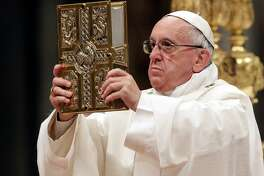 Pope Francis presides over a solemn Easter vigil ceremony in St. Peter's Basilica at the Vatican on Saturday.