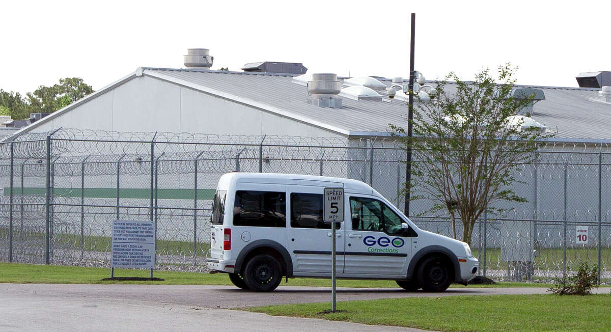 A van with the GEO Group, a private prison company, drives on the Joe Corley Detention Center property on Hilbig Road, Friday, April 14, 2017, in Conroe.