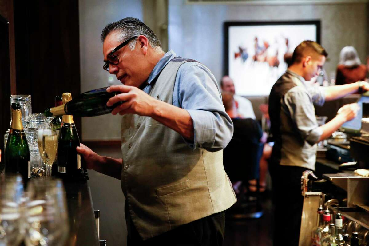 Cueva bartender Jose Guerra pours a drink on the first floor of the Marriott Marquis Thursday, April 6, 2017 in downtown Houston. Even though Guerra works downtown, he has to live outside Beltway 8 to find suitable housing that he can afford. ( Michael Ciaglo / Houston Chronicle)