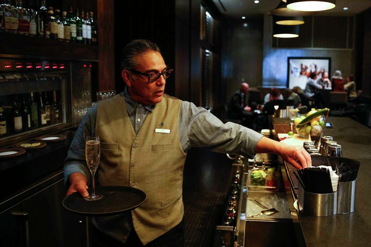 Cueva bartender Jose Guerra serves drinks on the first floor of the Marriott Marquis Thursday, April 6, 2017 in downtown Houston. Even though Guerra works downtown, he has to live outside Beltway 8 to find suitable housing that he can afford. ( Michael Ciaglo / Houston Chronicle)